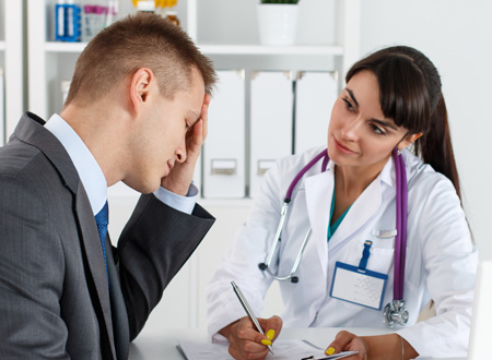 distraught man speaking with female doctor